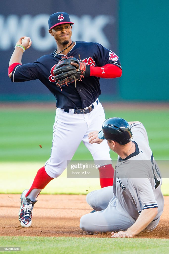 Shortstop Francisco Lindor #12 of the Cleveland Indians throws out New York Yankees Alex Rodriguez #13 of the New York Yankees at first as Chase Headley #12 is out at second for the double play to end the top of the first inning at Progressive Field on August 12, 2015 in Cleveland, Ohio.