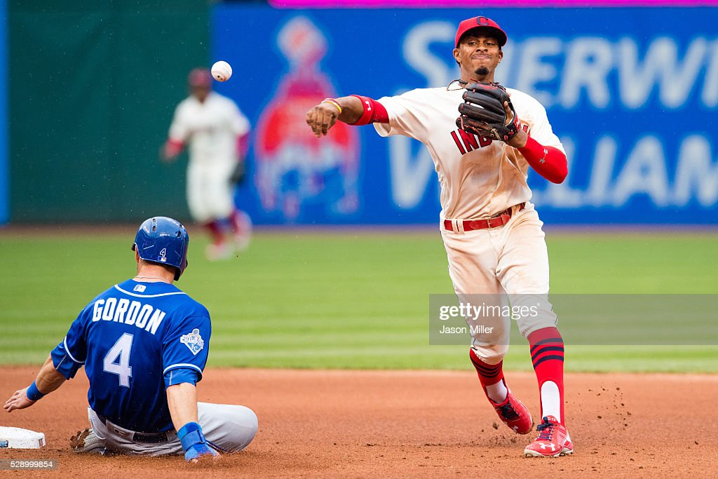 Shortstop Francisco Lindor #12 of the Cleveland Indians throws out Salvador Perez #13 of the Kansas City Royals at first as Alex Gordon #4 of the Kansas City Royals is out at second for a double play to end the top of the fourth inning at Progressive Field on May 7, 2016 in Cleveland, Ohio.