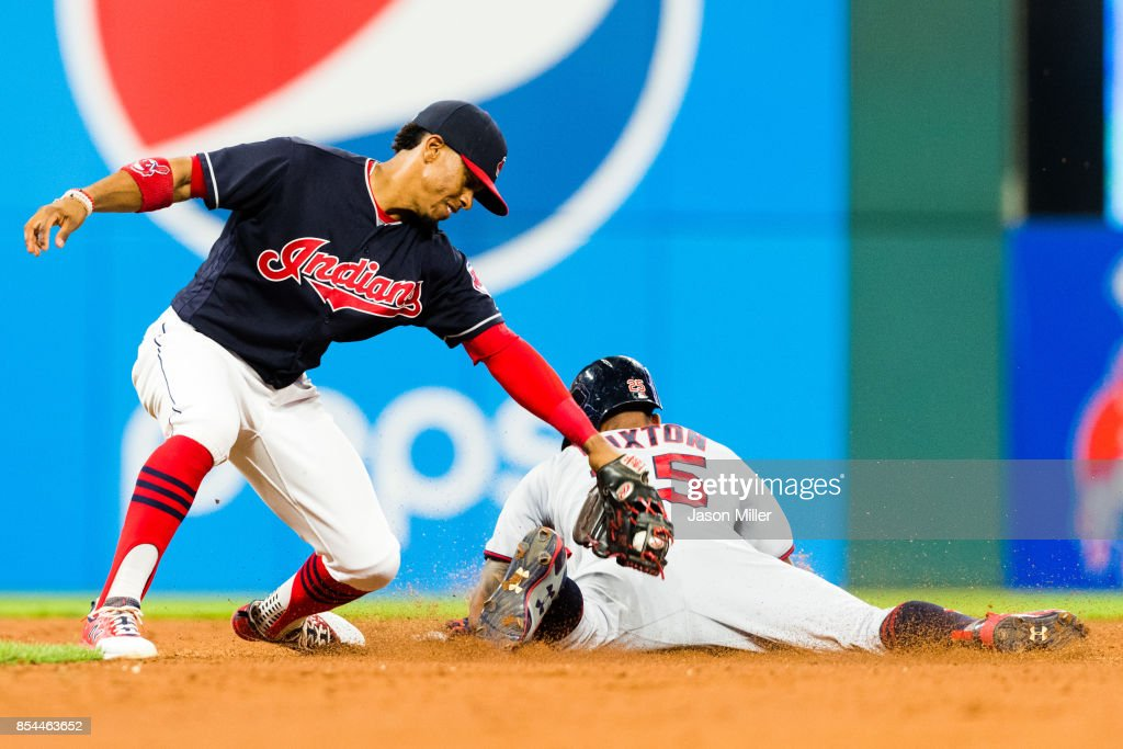 Shortstop Francisco Lindor #12 of the Cleveland Indians tries to tag out Byron Buxton #25 of the Minnesota Twins as he steals second during the sixth inning at Progressive Field on September 26, 2017 in Cleveland, Ohio.