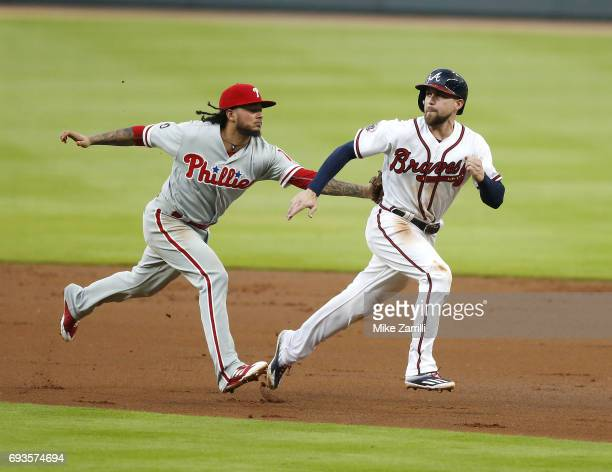 Shortstop Freddy Galvis of the Philadelphia Phillies tags centerfielder Ender Inciarte of the Atlanta Braves during a rundown in the first inning...