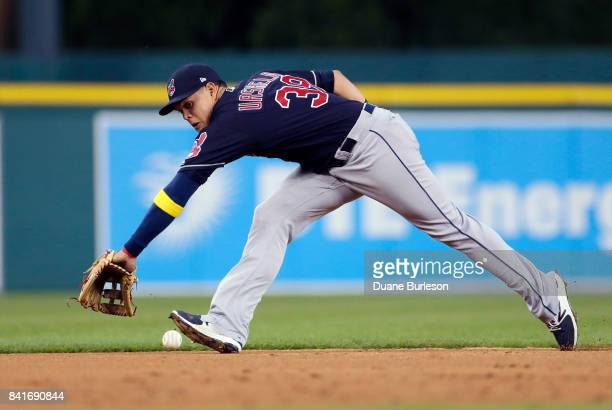 Shortstop Giovanny Urshela of the Cleveland Indians fields a grounder hit by Ian Kinsler of the Detroit Tigers and throws him out at first base...