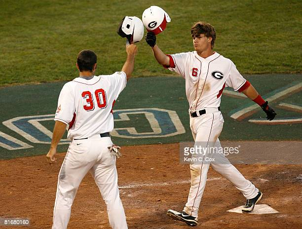 Shortstop Gordon Beckham of the Georgia Bulldogs celebrates his tworun homer as he crosses the plate in front of Matt Olson during Game 1 of the 2008...