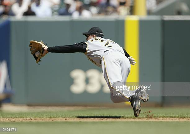 Shortstop Jack Wilson of the Pittsburgh Pirates dives for a ball hit by Edgardo Alfonzo of the San Francisco Giants during the National League game...