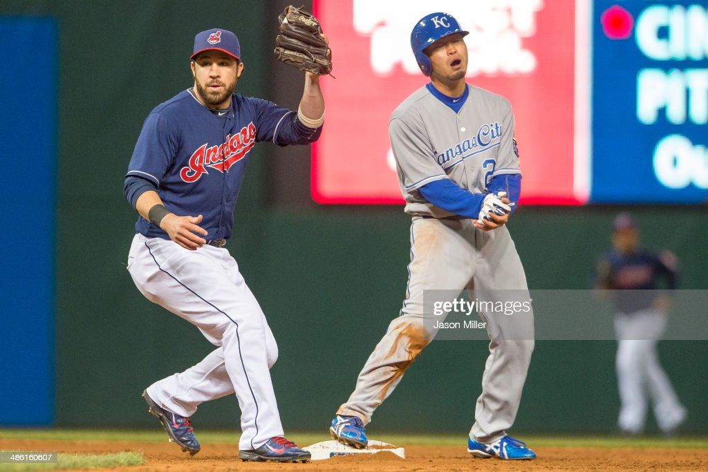 Shortstop Jason Kipnis #22 of the Cleveland Indians makes the play as Norichika Aoki #23 of the Kansas City Royals reacts after being tagged out on a steal attempt to end the top of the sixth inning at Progressive Field on April 22, 2014 in Cleveland, Ohio.