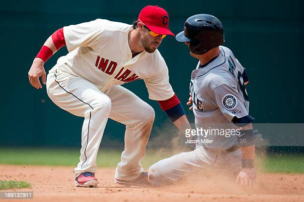 Shortstop Jason Kipnis of the Cleveland Indians tags out Brendan Ryan of the Seattle Mariners on an attempted steal during the seventh inning at...
