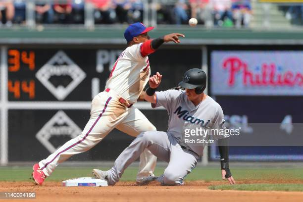 Shortstop Jean Segura of the Philadelphia Phillies gets the force at second base on Brian Anderson and throws to first base to complete the double...
