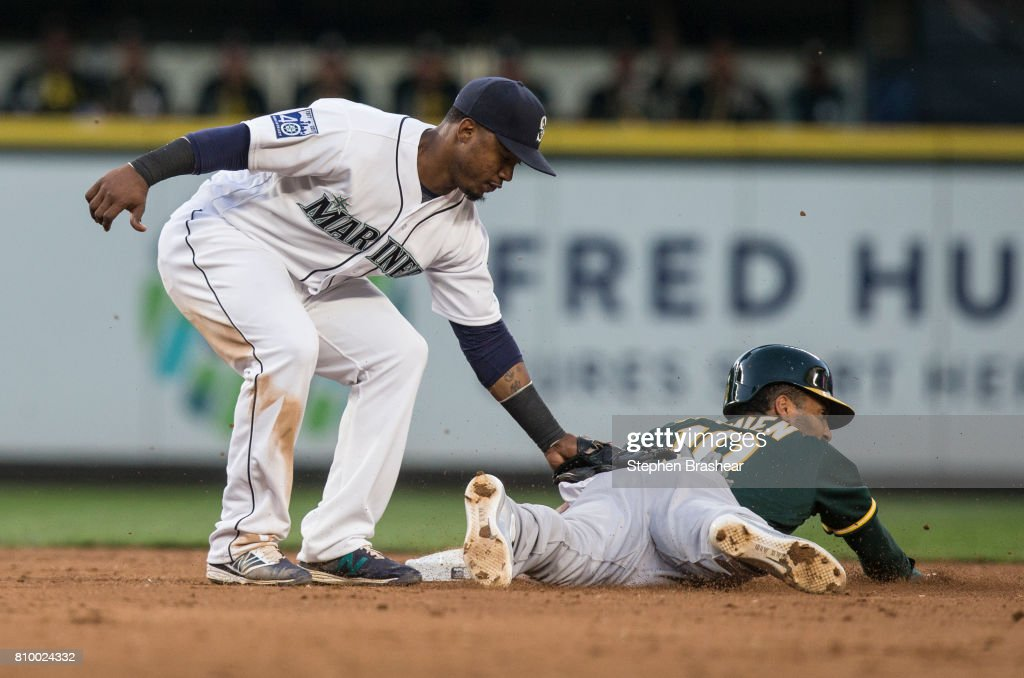 Shortstop Jean Segura #2 of the Seattle Mariners is unable put on a tag before Marcus Semien #10 of the Oakland Athletics is able to steal second base during the fifth inning of a game at Safeco Field on July 6, 2017 in Seattle, Washington.