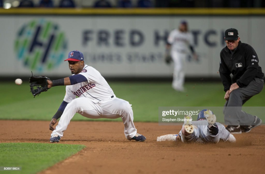 Shortstop Jean Segura #2 of the Seattle Mariners waits for a throw from catcher Mike Zunino #3 of the Seattle Mariners as Whit Merrifield #15 of the Kansas City Royals steals second base during the eighth inning of a game at Safeco Field on July 3, 2017 in Seattle, Washington.