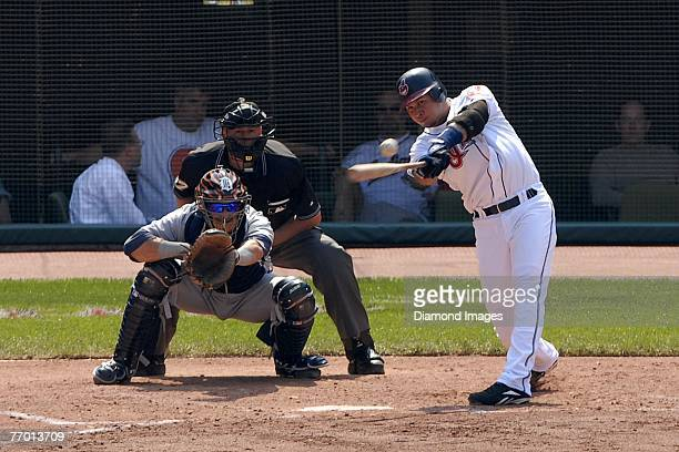 Shortstop Jhonny Peralta of the Cleveland Indians bats as catcher Michael Rabelo of the Detroit Tigers and homeplate umpire Gary Darling look on...