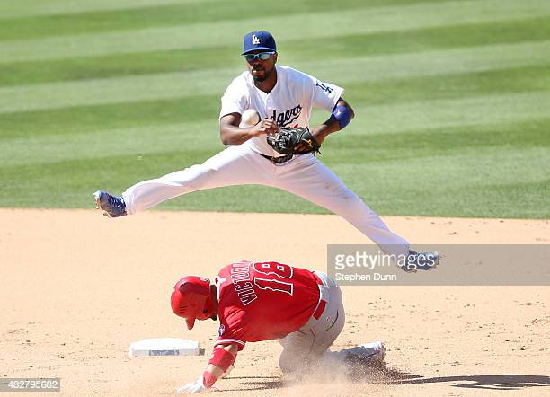Shortstop Jimmy Rollins of the Los Angeles Dodgers jumps over Shane Vicotrino of the Los Angeles Angels of Anahemi but is too late to turn the double...