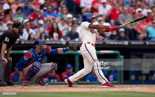 Shortstop Jimmy Rollins of the Philadelphia Phillies hits a single in the bottom of the fifth inning against the Chicago Cubs on June 14 2014 at...