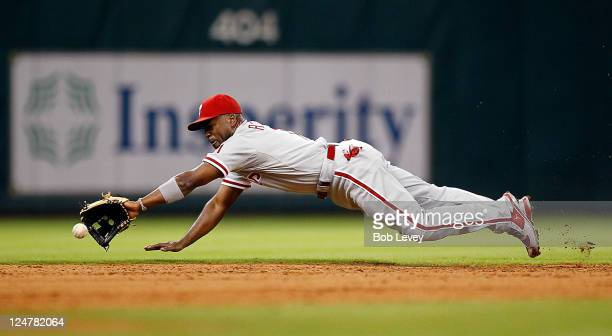 Shortstop Jimmy Rollins of the Philadelphia Phillies makes a diving attempt on a ball hit in the hole by Brett Myers of the Houston Astros at Minute...