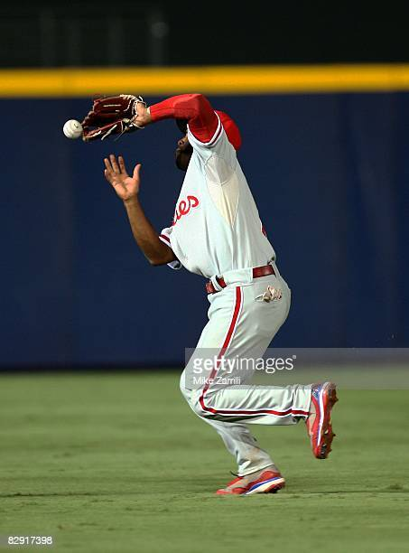 Shortstop Jimmy Rollins of the Philadelphia Phillies makes an error on a popup in the seventh inning during the game against the Atlanta Braves at...