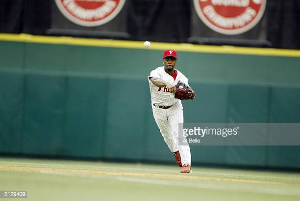 Shortstop Jimmy Rollins of the Philadelphia Phillies throws the ball to first base against the Boston Red Sox during interleague play at Veterans...
