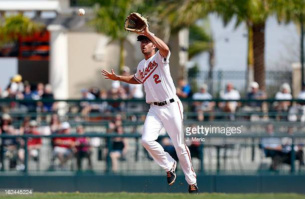 Shortstop JJ Hardy of the Baltimore Orioles fields a ball against the Minnesota Twins during a Grapefruit League Spring Training Game at Ed Smith...