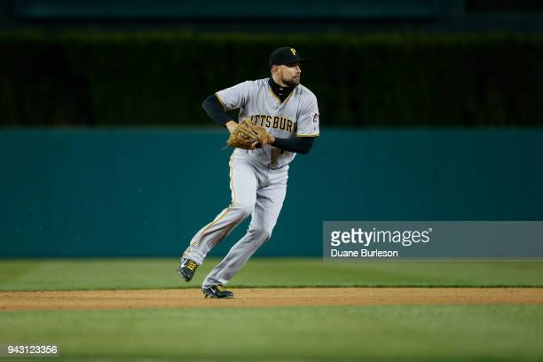 Shortstop Jordy Mercer of the Pittsburgh Pirates fields a grounder hit by Jose Iglesias of the Detroit Tigers for an out during game two of a...