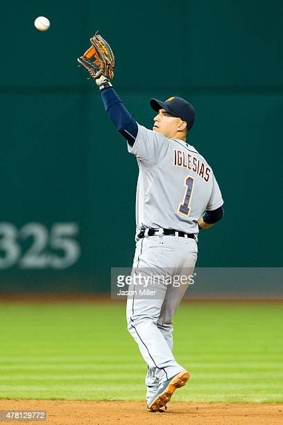 Shortstop Jose Iglesias of the Detroit Tigers catches a fly ball hit by Giovanny Urshela of the Cleveland Indians during the ninth inning at...