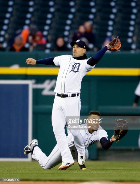 Shortstop Jose Iglesias of the Detroit Tigers catches a fly ball hit by Gregory Polanco of the Pittsburgh Pirates before colliding with left fielder...