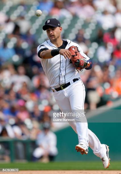 Shortstop Jose Iglesias of the Detroit Tigers throws out Alcides Escobar of the Kansas City Royals at first base on a grounder during the fifth...