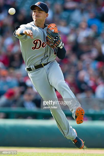 Shortstop Jose Iglesias of the Detroit Tigers throws out Jerry Sands at first to end the seventh inning at Progressive Field on April 12 2015 in...