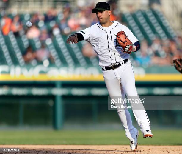 Shortstop Jose Iglesias of the Detroit Tigers throws out Yoan Moncada of the Chicago White Sox at first base during the ninth inning at Comerica Park...