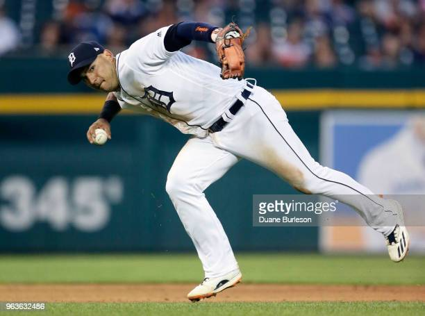 Shortstop Jose Iglesias of the Detroit Tigers throws wide of first base after fielding a grounder hit by Ian Kinsler of the Los Angeles Angels of...