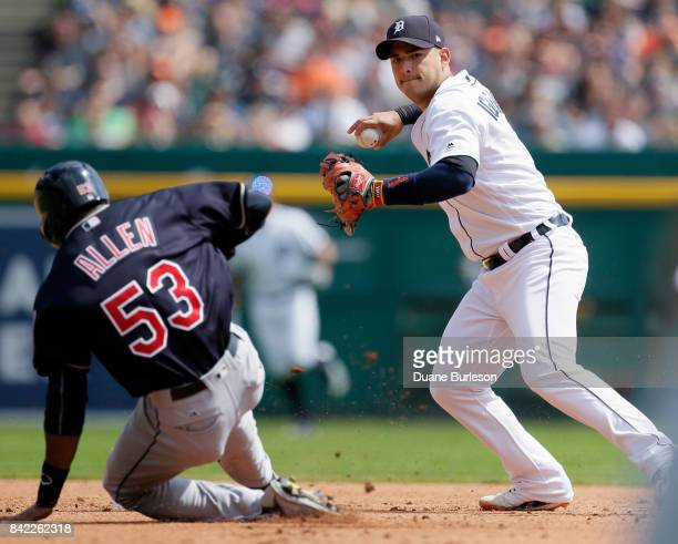 Shortstop Jose Iglesias of the Detroit Tigers turns the ball after getting a force out on Greg Allen of the Cleveland Indians during the second...