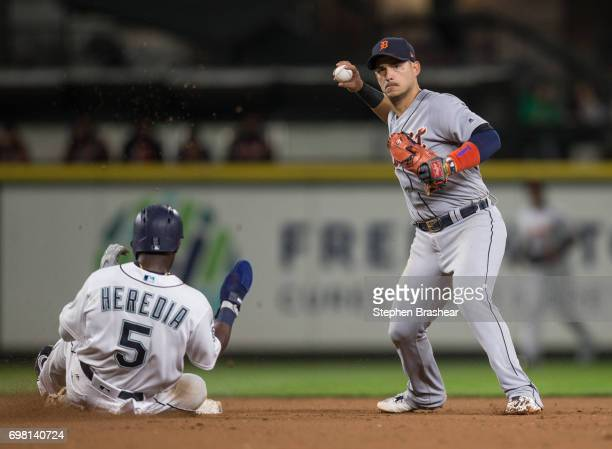 Shortstop Jose Iglesias of the Detroit Tigers turns the double play after forcing out Guillermo Heredia of the Seattle Mariners at second base on a...
