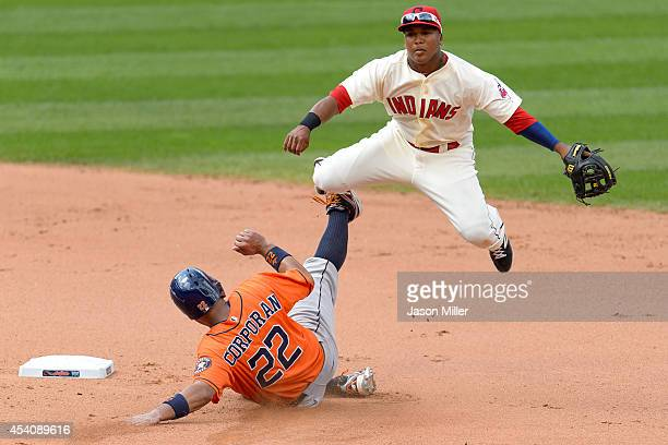 Shortstop Jose Ramirez of the Cleveland Indians throws out Jason Castro at first as Carlos Corporan of the Houston Astros is out at second during the...