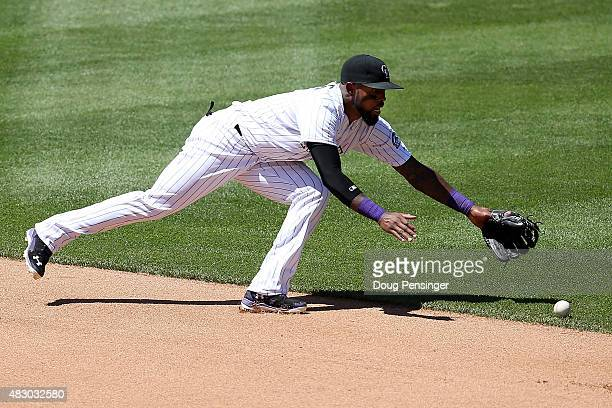 Shortstop Jose Reyes of the Colorado Rockies can't make the stop on an RBI single by Robinson Cano of the Seattle Mariners giving the Mariners a 10...