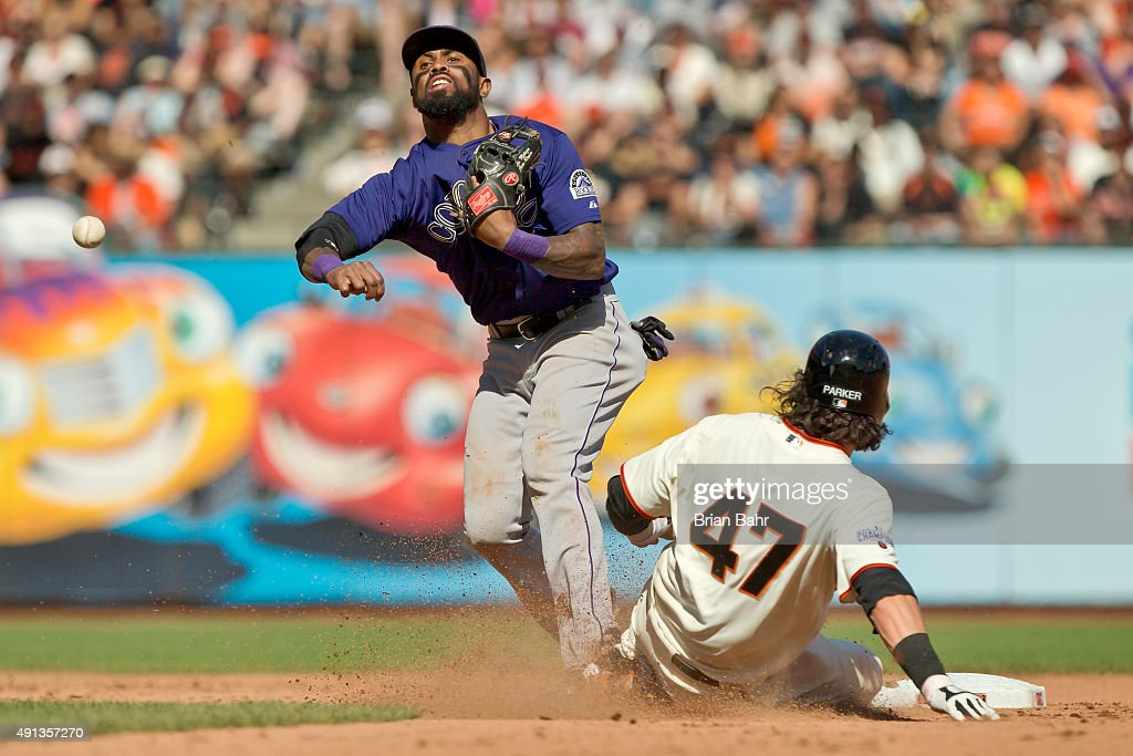 Shortstop Jose Reyes #7 of the Colorado Rockies catches Jarrett Parker #47 of the San Francisco Giants in a double play against Mac Williamson in the eighth inning at AT&T Park on October 4, 2015 in San Francisco, California, during the final day of the regular season. The Rockies won 7-3.