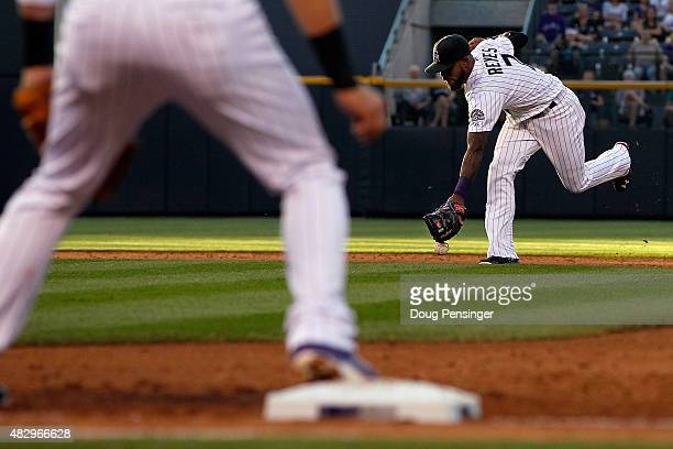 Shortstop Jose Reyes of the Colorado Rockies is unable to make a play on a soft ground ball by Nelson Cruz of the Seattle Mariners for single in the...