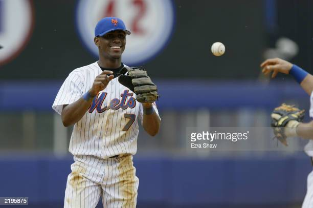Shortstop Jose Reyes of the New York Mets smiles as he plays catch during a break from the action against the Philadelphia Phillies in the National...