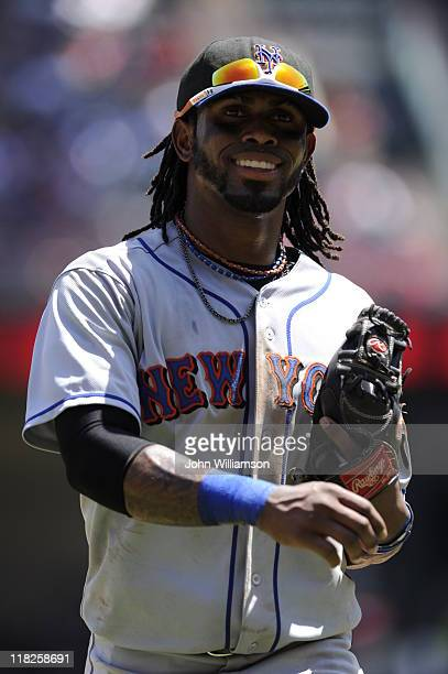 Shortstop Jose Reyes of the New York Mets smiles returns to the dugout after the third out of the inning in the game against the Texas Rangers at...