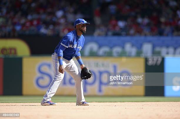 Shortstop Jose Reyes of the Toronto Blue Jays looks to home plate for the pitch from his position in the field during the game against the Texas...