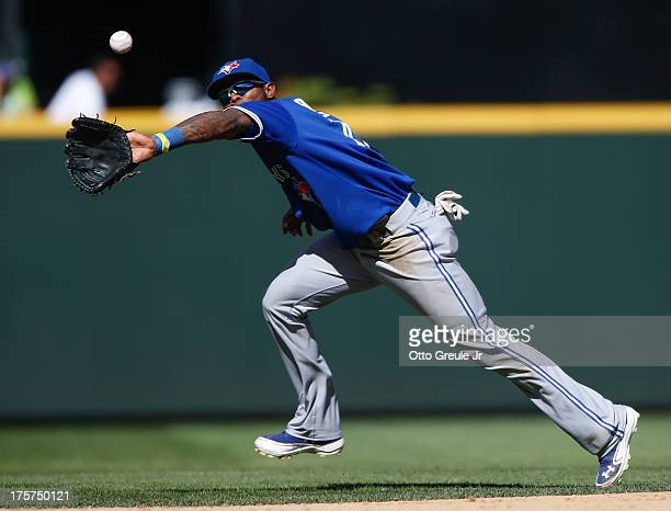 Shortstop Jose Reyes of the Toronto Blue Jays spears a line drive off the bat of Kyle Seager of the Seattle Mariners in the eighth inning at Safeco...
