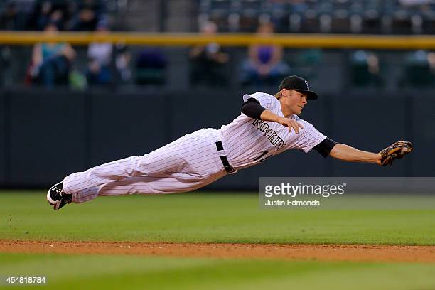 Shortstop Josh Rutledge of the Colorado Rockies makes a diving catch for the first out of the third inning against the San Diego Padres at Coors...
