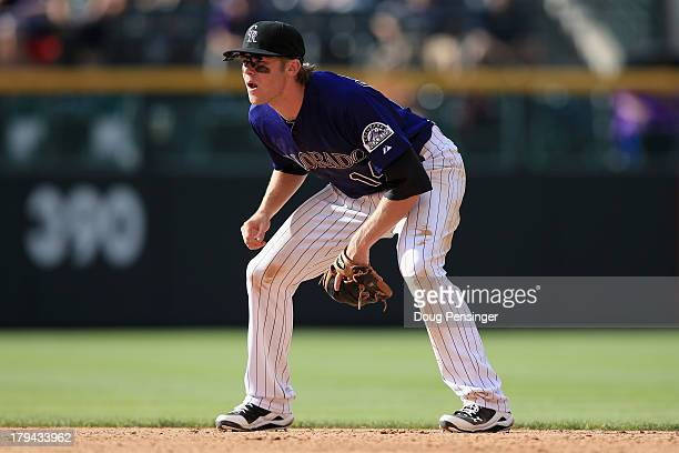 Shortstop Josh Rutledge of the Colorado Rockies plays defense against the Los Angeles Dodgers at Coors Field on September 2 2013 in Denver Colorado...