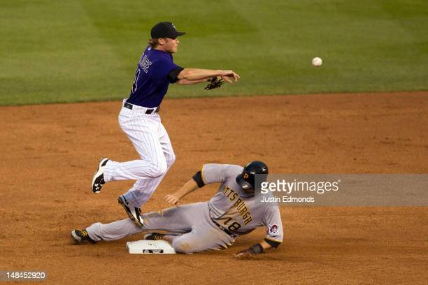 Shortstop Josh Rutledge of the Colorado Rockies throws to first base after getting lead runner Neil Walker of the Pittsburgh Pirates on a fielder's...