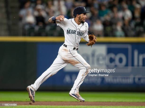 Shortstop JP Crawford of the Seattle Mariners throws to first base on the run after fielding a ground ball during a game against the Tampa Bay Rays...