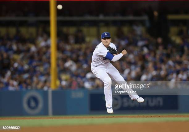 Shortstop Kike Hernndez of the Los Angeles Dodgers throws out Ttrevor Story of the Colorado Rockies in the seventh inning at Dodger Stadium on June...