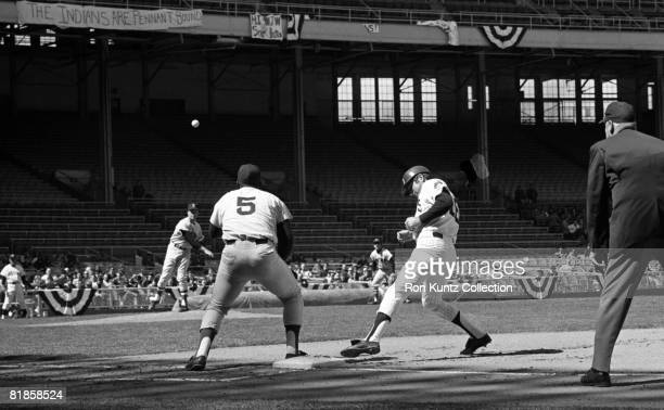 Shortstop Larry Brown of the Cleveland Indians gets back into firstbase safely as pitcher Cal Koonce of the Boston Red Sox throws a pickoff attempt...