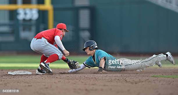 Shortstop Louis Boyd of the Arizona Wildcats tags out base runner Billy Cooke of the Coastal Carolina Chanticleers in the third inning during game...
