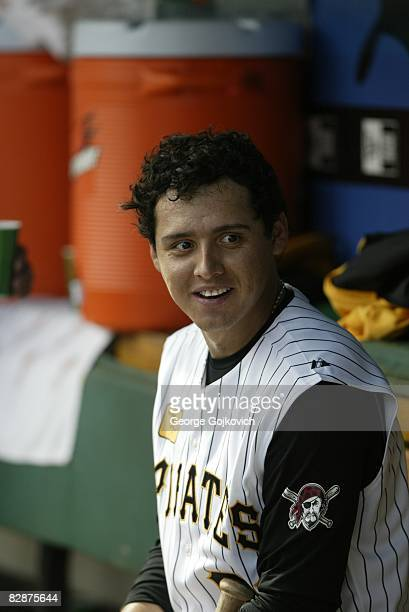 Shortstop Luis Cruz of the Pittsburgh Pirates smiles while sitting in the dugout during a game against the St Louis Cardinals at PNC Park on...