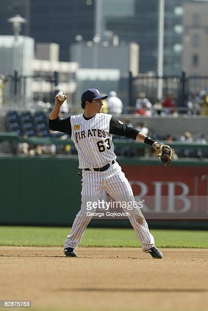 Shortstop Luis Cruz of the Pittsburgh Pirates throws to first base while warming up between innings during a game against the St Louis Cardinals at...