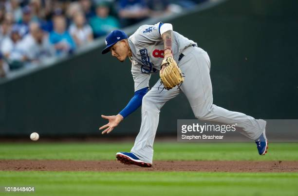Shortstop Manny Machado of the Los Angeles Dodgers fields a ball barehanded hit by Cameron Maybin of the Seattle Mariners during the second inning of...