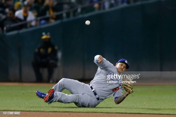 Shortstop Manny Machado of the Los Angeles Dodgers is unable to make a play to first base in the fourth inning against the Oakland Athletics at...