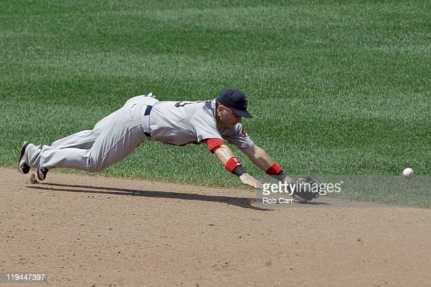Shortstop Marco Scutaro of the Boston Red Sox misses a single hit by Derrek Lee of the Baltimore Orioles during the sixth inning at Oriole Park at...