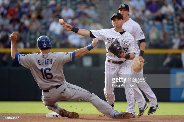 Shortstop Marco Scutaro of the Colorado Rockies turns a double play on Andre Ethier of the Los Angeles Dodgers on a ball hits a by Jerry Hairston Jr...
