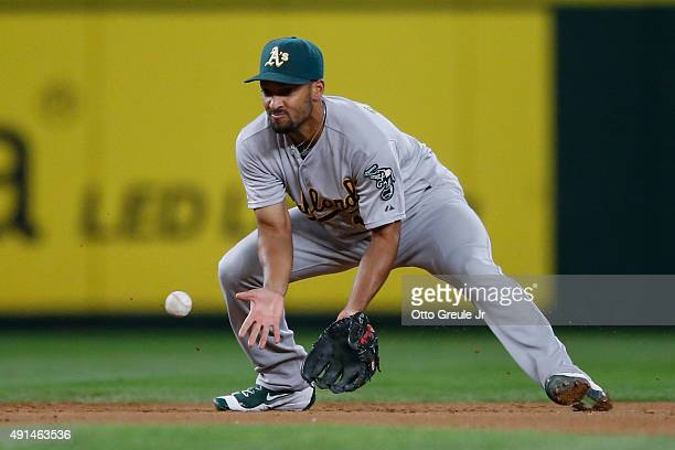 Shortstop Marcus Semien of the Oakland Athletics misplays a grounder off the bat of Ketel Marte of the Seattle Mariners in the fifth inning at Safeco...